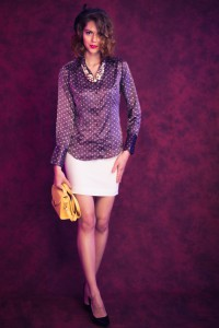 fashion model in front of purple and black mottle backdrop